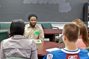 Poet Derrick Weston Brown speaks with students at Atholton High School. (Photo by Paige Feilhauer)
